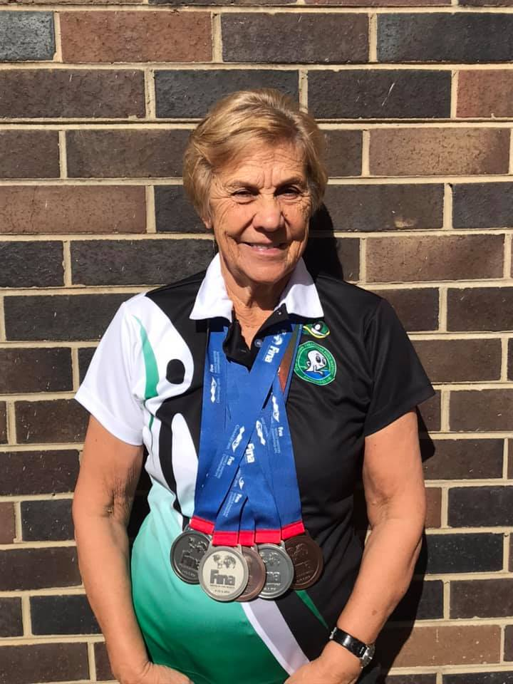 Annie with medals from Korea
